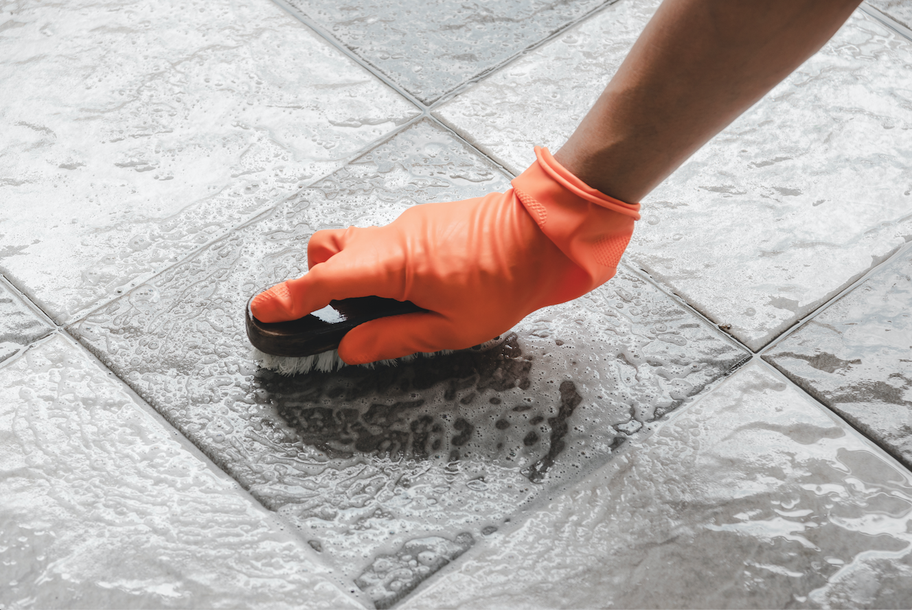 home owner cleaning tile floors